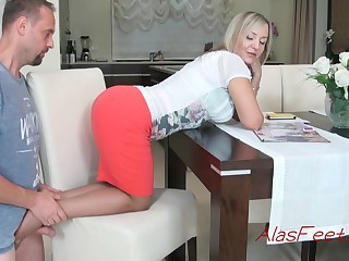Glamorous blond cougar is obtaining down on all fours on a catch stool, while providing a splendid footjob to her colleague