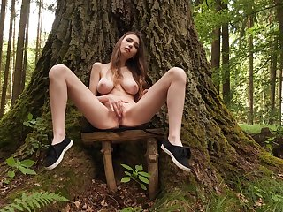 Big-chested Milla rubs her juicy sweet center in the woods