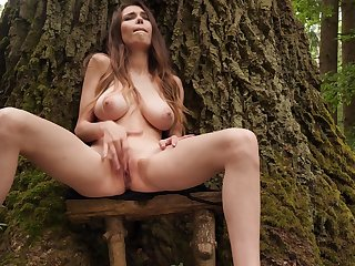 Busty babe feels so good fingering the pussy into the woods