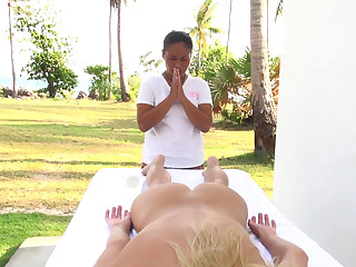Bare girl gets massaged