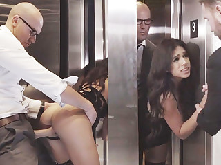Sneaky GF cheating close to her big-dicked boss on touching an elevator