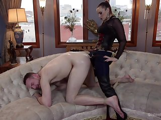 Strap-on anal for her male slave before sitting on his face