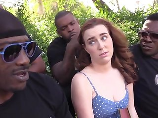 Young redhead chick gets many BBC in wild interracial gangbang