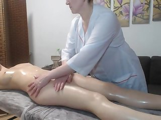 Lesbian mature pleased redhead girl with a massage