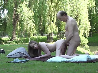 Young Lina Mercury makes love to an older man in the grass